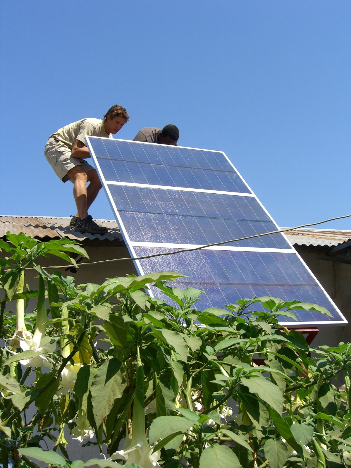 Installing solar panels onto remote medical clinic